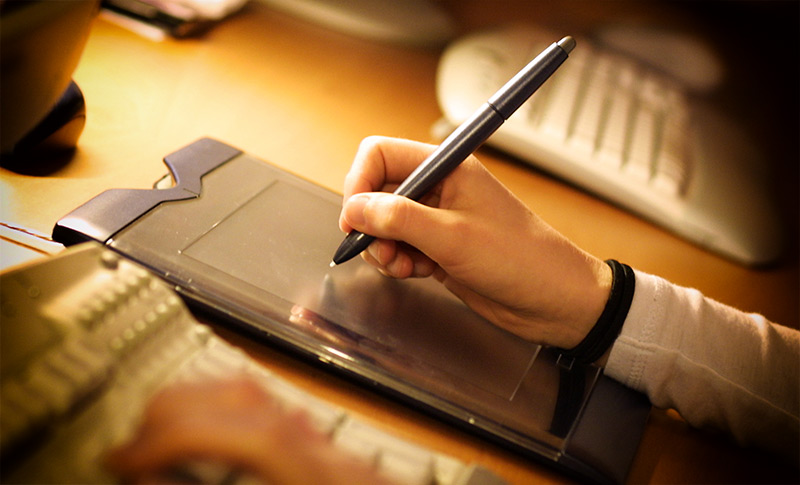 Graphics tablet and stylus in use