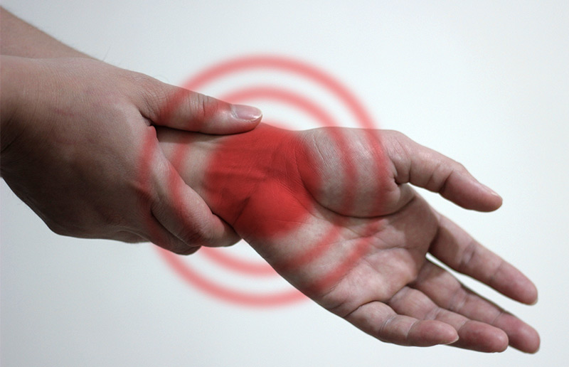 hands isolated on white demonstrating carpal tunnel syndrome pain