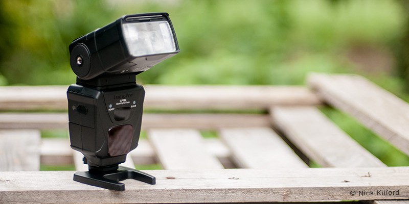 LumoPro LP 180 flash unit with shallow depth of field
